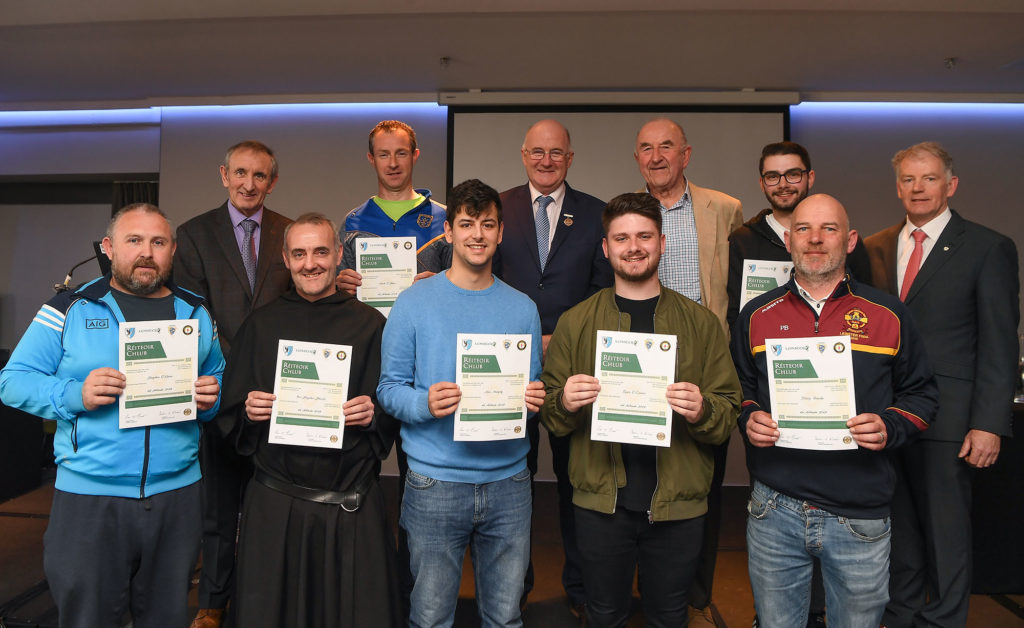 Brother Stephen and a group of people recieving certs on becoming referees.